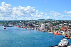 St John's Harbour in Newfoundland Canada. Panoramic view, Warm summer day in August. Panoramic views with bight blue summer day sky with puffy clouds over the royalty free stock photo