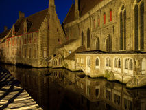 St. John's Hospital At Night. A view of St. John's Hospital in Bruges, Belgium as seen from across the canal at night Stock Images