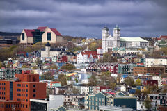 St. John's, Newfoundland. The colorful old city of St. John's, Newfoundland with its unique architecture.  The large building on the top left is the new art Stock Images