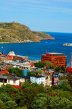 St. John's, Newfoundland. View of city and harbor of St. John's Newfoundland, Canada showing colorful houses, water and hills stock image