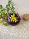 St. John's wort oil in bottle Stock Photos