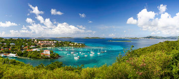 St. John, USVI - Beautiful Cruz Bay Panoramic. A wonderfully colorful view from above the fleet of sailboats and yachts anchored the harbor in Cruz Bay on the royalty free stock photo