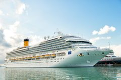 Ocean liner Costa Magica in sea port, antigua. St. Johns, Antigua - March 05, 2016: ocean liner cruise ship Costa Magica in sea port. Summer vacation, travel Royalty Free Stock Image