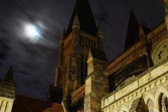 St Johns Cathedral. Long exposure fast moving clouds a backdrop for this amazing architecture. St Johns cathedral in Brisbane taken at night Royalty Free Stock Photos