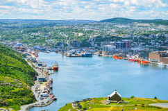St Johns Harbour in Newfoundland Canada.  Panoramic view, Warm summer day in August. Panoramic views with bight blue summer day sky with puffy clouds over the Royalty Free Stock Photos