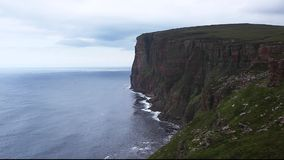 St Johns Head sea cliffs off coast of Orkney, Scotland stock video