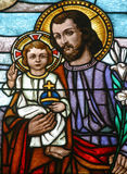 St. Joseph. Stained glass with st. Joseph holding baby Jesus Stock Photos