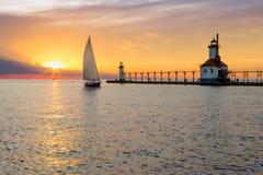 St. Joseph Lighthouse and Sailboat Solstice Sundown Royalty Free Stock Photos