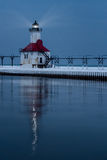 St. Joseph North Pier Lighthouse. An illuminated St. Joseph North Pier Lighthouse reflects in the water in Saint Joseph, Michigan on a Winter evening Royalty Free Stock Photos