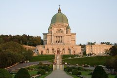 St-Joseph Oratory. Frontal view of the Montreal St-Joseph Oratory illuminated by the setting sun stock photography