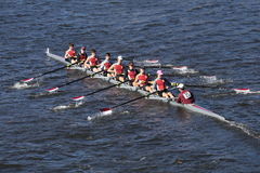 St. Joseph`s Collegiate Institute Crew races in the Head of Charles Regatta Men`s Youth Eight. BOSTON - OCTOBER 23, 2016: St. Joseph`s Collegiate Institute Crew Royalty Free Stock Images