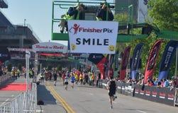 St Jude Rock n Roll Half Marathon Runners Reach the Finish Line. Runners in the 2019 St. Jude Rock n Roll Half Marathon in Nashville, Tennessee, run the final stock photos