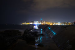 St Julian`s Bay at night, Malta. ST. JULIAN`S - MALTA, 29 March 2017: Lights and reflections in St Julian`s Bay in evening. Saint Julian`s is a town in the Royalty Free Stock Image