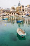 ST. JULIAN`S, MALTA - March 6, 2018: View of Spinola Bay at St. Julian`s, Malta with boats and buildings. ST. JULIAN`S, MALTA - March 6, 2018: View of Spinola Stock Photo