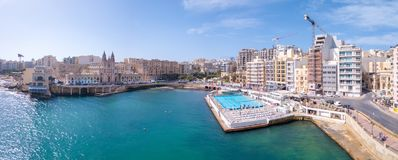 ST.JULIAN`S, MALTA, MAY 15, 2018 - Aerial view on the Spinola Ba. Y with outside pool in St.Julian`s from above - St.Julian`s, Malta Stock Image