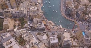 Aerial view on the Spinola Bay. ST.JULIAN`S, MALTA, MAY 15, 2018 - Aerial view on the Spinola Bay with outside pool in St.Julian`s from above - St.Julian`s stock video footage
