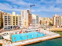 Aerial view on the Spinola Ba. ST.JULIAN`S, MALTA, MAY 15, 2018 - Aerial view on the Spinola Bay with outside pool in St.Julian`s from above - St.Julian`s, Malta Stock Photography