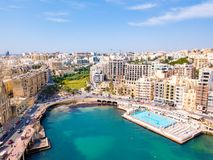 Aerial view on the Spinola Ba. ST.JULIAN`S, MALTA, MAY 15, 2018 - Aerial view on the Spinola Bay with outside pool in St.Julian`s from above - St.Julian`s, Malta Stock Image