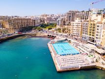ST.JULIAN`S, MALTA, MAY 15, 2018 - Aerial view on the Spinola. Bay with outside pool in St.Julian`s from above - St.Julian`s, Malta Royalty Free Stock Photos