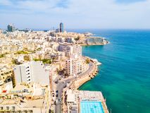 ST.JULIAN`S, MALTA, MAY 15, 2018 - Aerial view on the Spinola Ba. Y with outside pool in St.Julian`s from above - St.Julian`s, Malta Stock Images