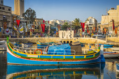 St.Julian`s, Malta - Traditional colorful Luzzu fishing boat. At Spinola bay at sunrise Royalty Free Stock Images