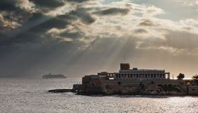 St Julians, Malta. With the casino and a cruise ship Royalty Free Stock Photography