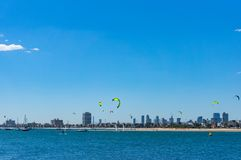 St Kilda Beach with Melbourne cityscape on the background. Melbourne, Australia - December 7, 2016: St Kilda Beach with kite surfers and Melbourne cityscape on Stock Photography