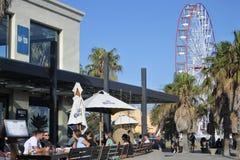 St Kilda Beach Melbourne Victoria Australia. Visitors at St Kilda Beach, a very popular tourist attraction in Port Philip Bay in Melbourne Victoria Australia stock image