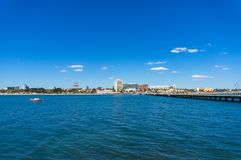 St. Kilda beach view with Melbourne suburb and pier. St. Kilda beach view with Melbourne waterfront suburb and St. Kilda pier on sunny day Stock Image