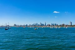 St. Kilda beach with yachts, boats and Melbourne cityscape. On the background Stock Images