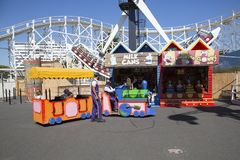 Luna Park - Melbourne. St Kilda, Melbourne, Australia: March 18, 2017: Children ride a Kiddy Train at Melbourne`s Luna Park. The historic amusement park is Stock Photography