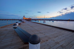 St. Kilda Pier at Dusk with boats in the harbour Royalty Free Stock Image