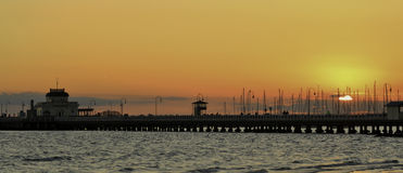 Sunset at StKilda Pier. Sunset behind St Kilda pier in the Autumn Stock Photo