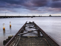 St Kilda Rails sunrise. Yacht club boat dock to transfer ships on water in Melbourne bay at St Kilda, sunrise time Royalty Free Stock Photos