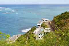 St Kitts south coast. Buildings on a hill, St Kitts south coast in the Caribbean Stock Images