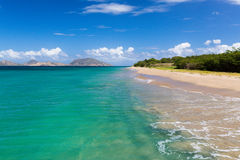 St Kitts taken from a beach on St Nevis. View of St Kitts taken from a beach on St Nevis in the Caribbean Stock Image