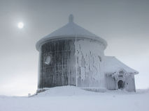St. Lawrence chapel on Sniezka Mountain in Karkonosze Mountains. Baroque St. Lawrence chapel during winter on the highest peak of Karkonosze Mountains - Sniezka Stock Images