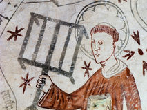St. Lawrence holding a gridiron and a book Stock Image