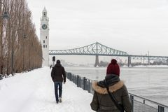 St. Lawrence River with Clock tower in Old Montreal, in winter. Montreal, CA - 21 February 2019: St. Lawrence River, Clock tower and Jacques Cartier Bridge in stock photos