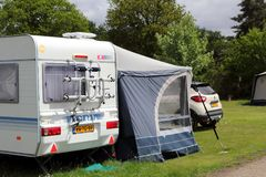 St Leonards, Hampshire, UK - May 30 2017: Caravan, awning and ca. R with Dutch or Netherlands registration, camping on a campsite in England stock images
