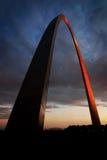 St Louis Arch Metal Gateway Landmark Sunset Glowing Orange. St Louis Arch landmark metal gateway sunset glowing orange Royalty Free Stock Photos