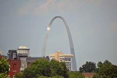 St. Louis Arch Outlines the buildings. Photo of the Saint Louis Arch in the background of buildings Royalty Free Stock Photo
