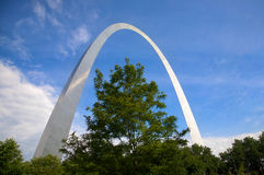 St. Louis arch and tree. An interesting view of the St. Louis Arch - Gateway to the West - the Jefferson National Expansion Memorial (U.S. National Park Service Royalty Free Stock Photography