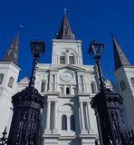 The St Louis Cathedral in Jackson Square of the French Quarter in New Orleans Louisiana. The St Louis Cathedral and water fountain in Jackson Square of the stock photo