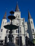 The St Louis Cathedral in Jackson Square of the French Quarter in New Orleans Louisiana. The St Louis Cathedral and water fountain in Jackson Square of the stock images