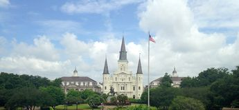St. Louis Cathedral and Jackson Square in New Orleans. A panorama of Jackson Square gardens and the historic Saint Louis Cathedral, a popular tourist destination Stock Photo