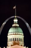 St. Louis landmarks. A nighttime view of two well-known landmarks, the historic Old Courthouse in downtown St. Louis, Missouri with the famous Gateway Arch Stock Photos