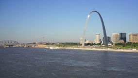 St Louis Missouri Downtown City Skyline Arch Gateway West. The Mississippi River passes by in front of downtown St Louis stock video footage