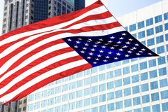 St Louis, Missouri, United States-circa 2014-Large American Flag Flying in the Wind in Front of Modern Glass Buildings Downtown Stock Photo