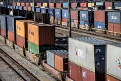 St. Louis, Missouri, United States-circa 2018-long line of train well cars and double stack freight container cars in trainyard stock image